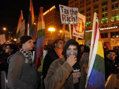 "Protesters during an ""Occupy Chicago"" march and protest at Grant Park ."