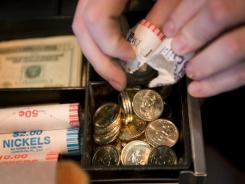 The Government Accountability Office says that about $1.1 billion in $1 coins showing U.S. presidents sits unused in vaults.