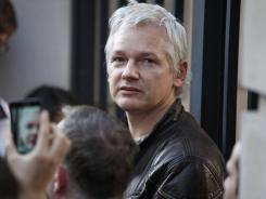 Wikileaks founder Julian Assange addresses the media during the Occupy London Stock Exchange demonstration on Saturday.