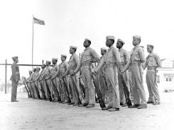 Montford Point Marine recruits stand at parade rest in April 1943 in New River, N.C. Nearly 70 years after the Marine Corps accepted segregated black units, the Marine Corps' top general is pushing to honor the history of the Montford Point Marines.