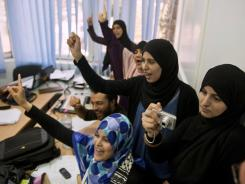 Supporters of the Islamist party Ennahda celebrate Tuesday at the group's headquarters in Tunis, Tunisia.