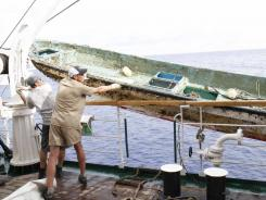 A Japanese fishing boat was hauled out of the Pacific Ocean by a Russian ship on Monday. That boat  and other debris have been found in the Pacific at a location suggesting that flotsam from Japan's tsunami is drifting east faster than expected, researchers say.