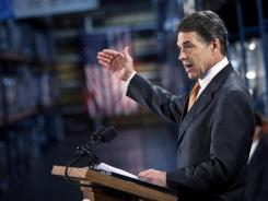 GOP presidential candidate Rick Perry outlines his flat tax plan Tuesday at the ISO Poly Films factory in Gray Court, S.C. The plan also would eliminate the estate tax and capital gains tax.
