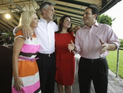 Jeb Bush Jr., right, endorsed Jon Huntsman, with wife Mary Kaye Huntsman, left, and  Ana Navarro, the Huntsman campaign's national Hispanic chairwoman, on Aug. 10 in Miami.
