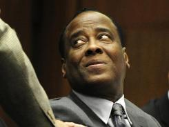 Dr. Conrad Murray acknowledges a former patient of his that testified as a character witness during Murray's involuntary manslaughter trial in the death of singer Michael Jackson in Los Angeles on Wednesday.