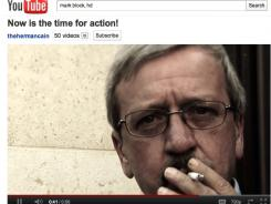 Web sensation: &quot;Smoking Man&quot; features Herman Cain's chief of staff, Mark Block, endorsing Cain and smoking a cigarette.