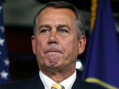 House Speaker John Boehner participates in his weekly media briefing at the Capitol on Thursday.