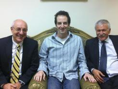 Ilan Grapel, a U.S.-Israeli citizen arrested in Egypt, pictured in center, has been freed in a prisoner swap.