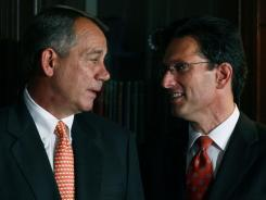 House Speaker John Boehner of Ohio and House Majority Leader Eric Cantor of Virginia participate in a news conference at the Republican National Committee headquarters on Oct. 12 in Washington, D.C.