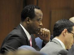 Conrad Murray listens as Dr. Paul White is questioned during Murray's involuntary manslaughter trial in Los Angeles on Oct. 28.