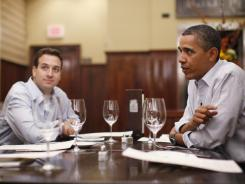 "President Obama has dinner with winners of the ""Dinner with Barack"" campaign contest at The Liberty Tavern in the  Arlington, Va., on Thursday."