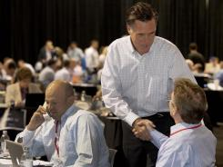 Republican presidential candidate Mitt Romney greets supporters during a phone bank fundraiser May 16, 2011, in Las Vegas.