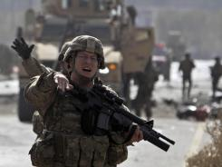 U.S. soldiers are at the site of a suicide car bombing Saturday in Kabul, Afghanistan.