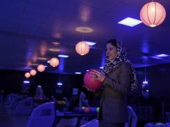 Meena Rahmani opened Afghanistan's first bowling alley, offering a place where men, women and families can gather, relax and have fun.