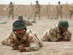 Iraqi soldiers work through a combat course in July 2007. Some military analysts worry the U.S. withdrawal this year could jeopardize Iraqi forces' counterterrorism efforts.