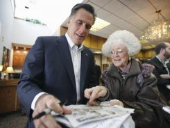 GOP presidential candidate Mitt Romney meets Jeanne Dietrich before speaking Oct. 20 in Treynor, Iowa.