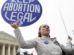 Women's rights : Meaghan Lamarre of Takoma Park, Md., protests at the Supreme Court.