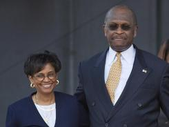 Gloria Cain accompanies her husband, Herman Cain, May 21 as he announces his run for Republican presidential candidate in Atlanta.