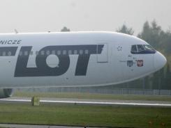A Boeing 767 of Polish LOT airlines makes an emergency landing Tuesday in Warsaw.