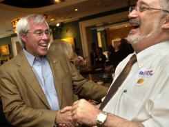 U.S. Rep. John Barrow, D-Ga., left, laughs with supporter Patrick Shay, a Chatham County commissioner, as results rolled in for Georgia's Democratic Primary in Savannah, Ga. in February 2008. Less than 50 years ago, every member of the U.S. House from the Deep South was a white Democrat. Now just one remains: John Barrow, of Savannah, Ga. Barrow faces a tough re-election having lost the city of Savannah to redistricting.