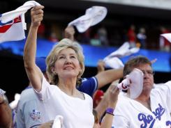 Retiring Sen. Kay Bailey Hutchison, R-Texas, swings a towel in support of the Texas Rangers before Game 2 of baseball's American League division series playoffs against the Tampa Bay Rays in October. A crowded field of GOP hopefuls is forming to take Hutchison's spot.