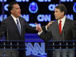 Hand-to-hand debate:  Former Massachusetts governor Mitt Romney, left, and Texas Gov. Rick Perry face off last month. The next Republican presidential debate is scheduled for Wednesday in Michigan.