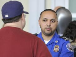 Chatting it up : A TSA agent interviews a flier in Boston.