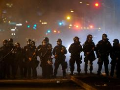 Sheriff's deputies advance on Occupy Oakland protesters on Thursday.