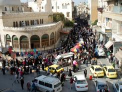 A handout picture released Wednesday by the Syrian Arab News  shows Hama, as Muslims prepared across the globe for the Eid al-Adha holiday which marks the end of the hajj pilgrimage season to mecca.