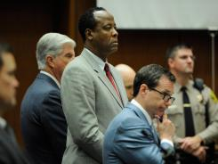 Conrad Murray stands with defense attorneys prior to the start of closing arguments and court proceedings on Thursday in Los Angeles.