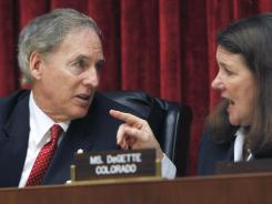 Rep. Cliff Stearns, left, talks with the subcommittee's Rep. Diana DeGette during a hearing on Solyndra's loan.