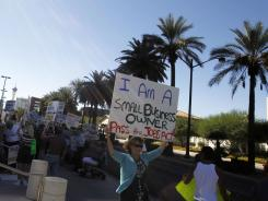 People rally for jobs in Las Vegas Oct. 13. Nevada's unemployment rate is highest in the nation and jobs are a top voter issue in the swing state.