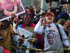 Supporters of Michael Jackson react outside the courthouse. The jury deliberated for eight hours and 34 minutes over two days.