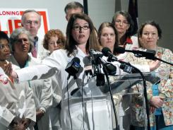 """Dr. Shani Meck, a Flowood, Miss., obstetrician, announces her support for the """"personhood"""" amendment during a news conference in Jackson, Miss., Thursday, with like-minded doctors and nurses."""