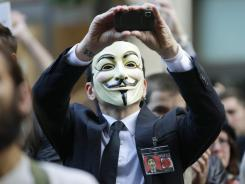 "A protester with the ""Occupy Seattle"" movement wears a Guy Fawkes mask on Oct. 15. The masks are modeled on a 17th-century English terrorist, who is often now seen as a freedom fighter."