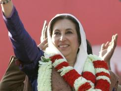 In this 2007 photo, Pakistan's former prime minister Benazir Bhutto waves to her supporters at a rally shortly before her assassination in Rawalpindi. Bhutto was assassinated with 20 others in a suicide attack as she left the rally.