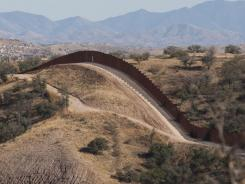 The border fence stretches west of Nogales, Ariz., into the Coronado National Forest.