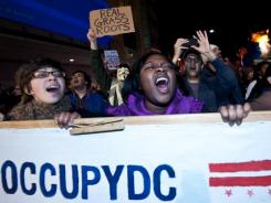 Protesters from Occupy DC march past the Washington Convention Center.