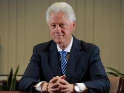 """The purpose of this book is to say you're always better off doing something,"" says former president Bill Clinton."