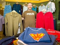 Dana Begins shows off hemp clothing available at The Hempest in Burlington, Vt.