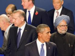 President Obama joins Turkish Prime Minister Recep Tayyip Erdogan, left, and Indian Prime Minister Manmohan Singh before they're assembled for a group photo Thursday at the G-20 summit in Cannes, France.