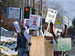Occupy Pocatello demonstrators go down South Fourth Street.