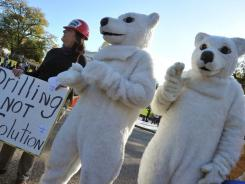 Demonstrators dressed as polar bears protest Sunday outside the White House against a planned 1,700-mile-long oil pipeline.