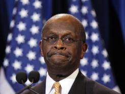 Republican presidential candidate Herman Cain speaks to reporters about  sexual misconduct allegations against him.