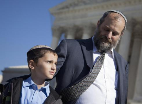 Supreme Court case involving child born to American Orthodox Jews in Jerusalem has Obama defending Bush policy he once denounced