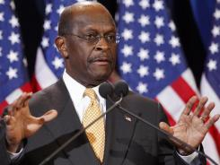 Republican presidential candidate Herman Cain addresses the media Nov. 8.