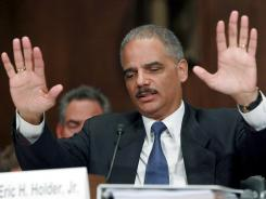 Attorney General Eric Holder gestures while answering questions Tuesday during a Senate Judiciary Committee Hearing on Capitol Hill.