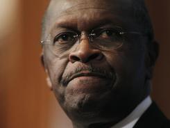 Republican presidential candidate Herman Cain answers questions at the National Press Club in Washington about sexual harassment allegations.