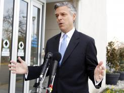 "Republican presidential candidate former Utah Governor Jon Huntsman speaks with the media after an interview on NBC's ""Meet the Press"" outside the NBC studio in Washington on Sunday."