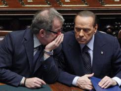 Roberto Maroni, Italy's interior minister, left, speaks with Prime Minister Silvio Berlusconi during a voting session Tuesday in Rome.